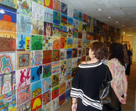 Art enthusiasts enjoy the student artwork  created as part of the Art4Athlete program.